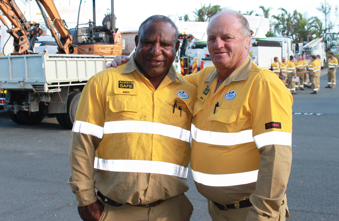 Image of two men in Ergon Energy uniforms