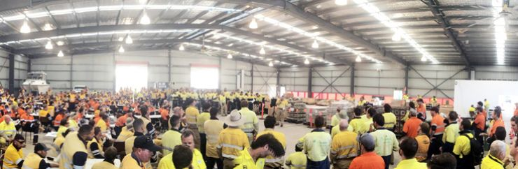 Image of mass meeting of field staff in yellow uniforms