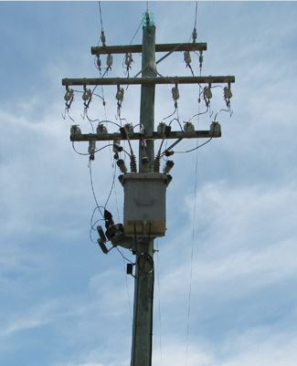 Power pole with satellite technology attached