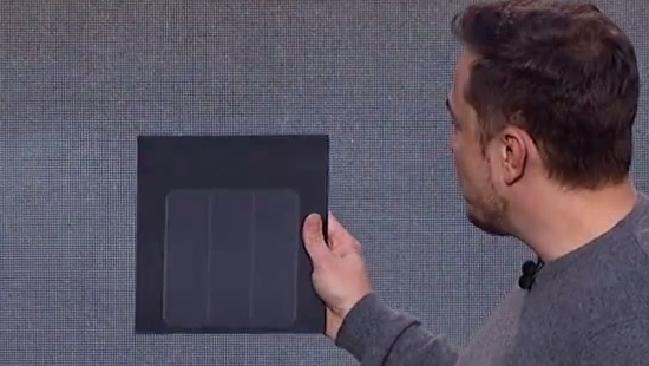 Image of Elon Musk showing a solar roof tile
