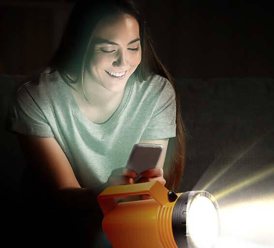 Woman with a mobile phone and torch