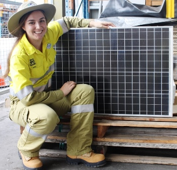 Alice Fleetwood inspecting solar panels